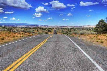 road under blue sky - road trip