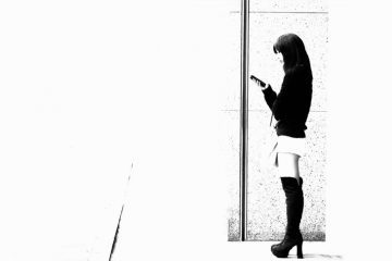Woman texting on street