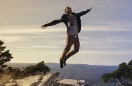 Young man jumping on rock - Age Ain't Nothing but a Number