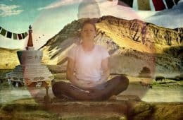 Meditator meditating among mountains