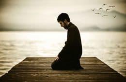 Man praying on dock