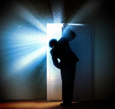 Man opening door and seeing light