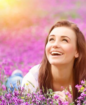 Girl lying in flowers - Bumper sticker wisdom