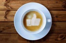 coffee cup with thumbs up in foam - participation in a virtual world