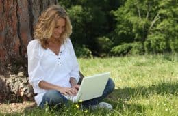 Woman on laptop outside - Dating in the digital age