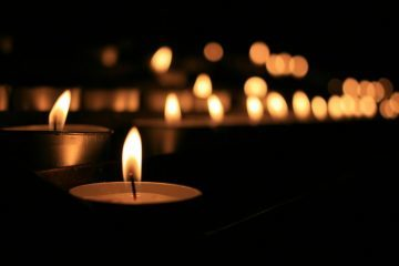 lit tealight candles - keeping kind in a time of loss