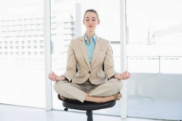 Businesswoman meditating in chair - Just One Breath meditation