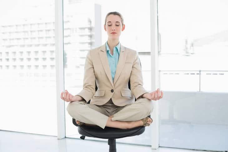 Businesswoman meditating in chair - Just One Breath meditation