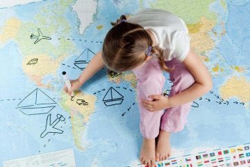 Child sitting on map