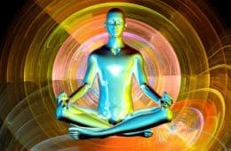 Art - android sitting in lotus position surround by psychedelic images