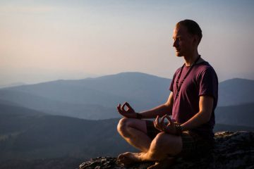 Man meditating on rock - Journey towards inner peace