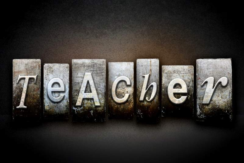 The word teacher in old typeface