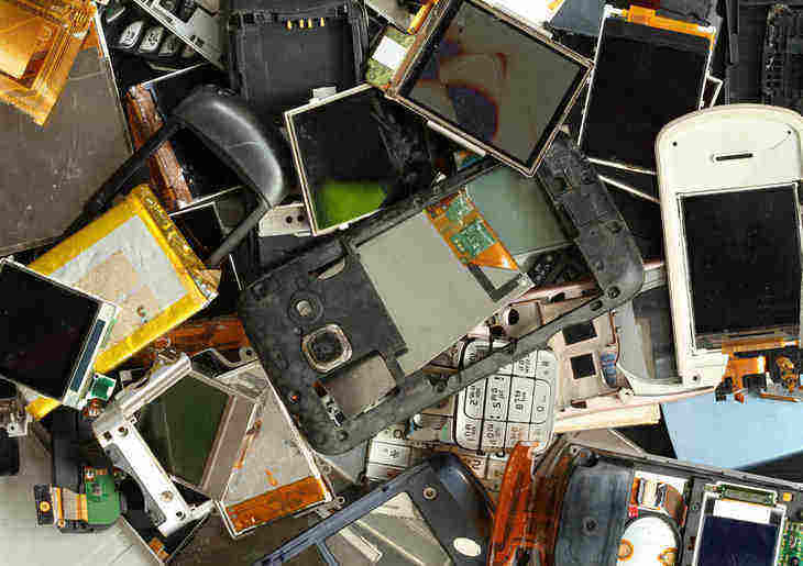 pile of broken cell phones - im/materialism
