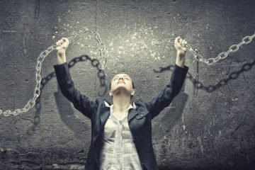Woman breaking chains - Why we need freedom