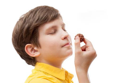 Boy smelling chocolate - Being present in life