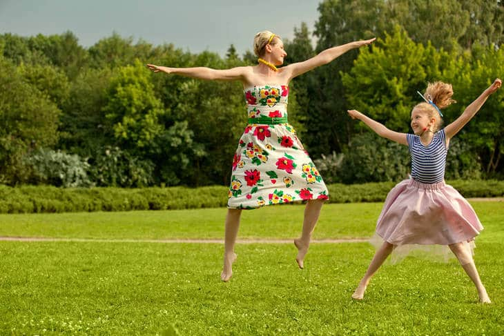 Mother and daughter dancing - Impact of karma on relationships