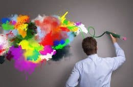 Man drawing colours on wall