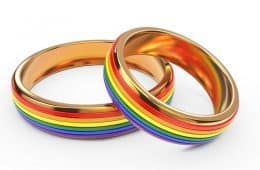 Two wedding rings with rainbow designs