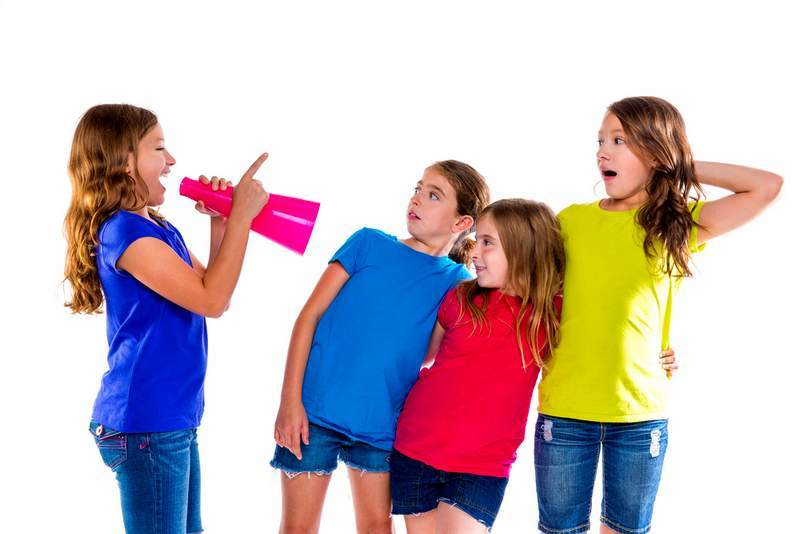 Girl with megaphone giving orders to three girls