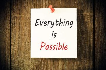 "Sign against a wall that says, ""everything is possible"""