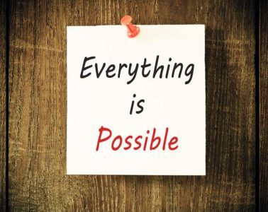 """Sign against a wall that says, """"everything is possible"""""""