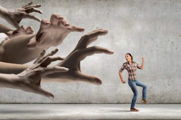 woman running away from a bunch of hands