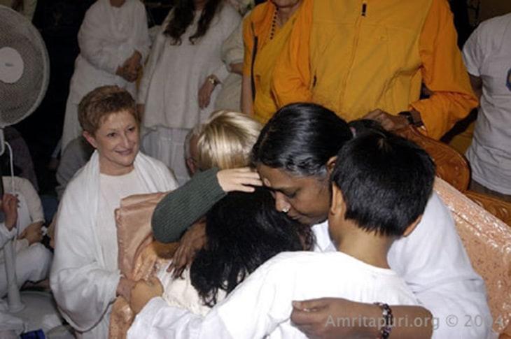 Amma hugging children