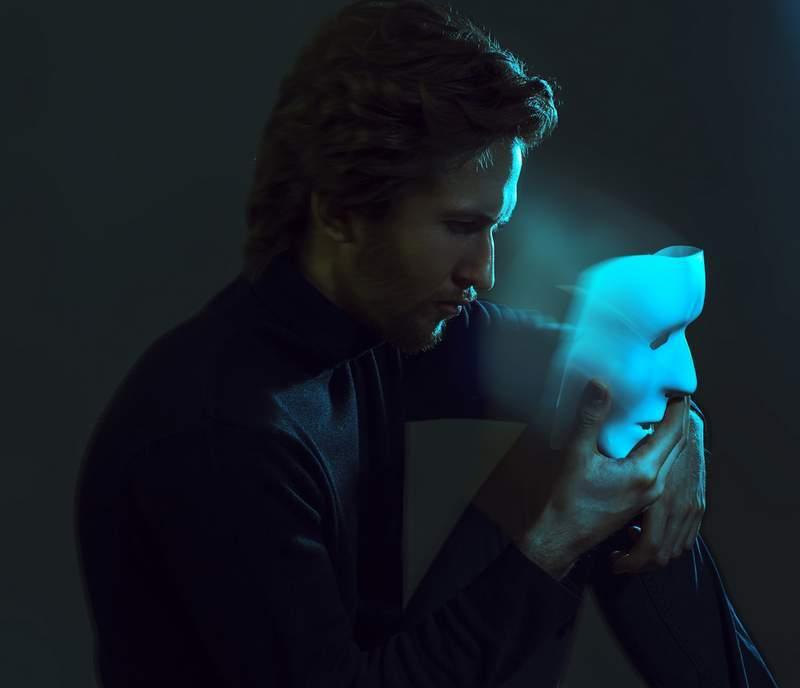 Man looking at a mask