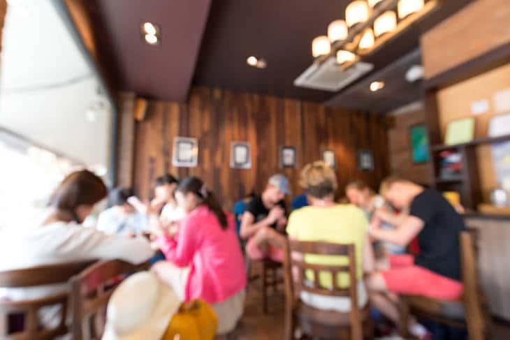 People talking in coffee shop