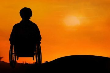 Silhouette of person in a wheelchair