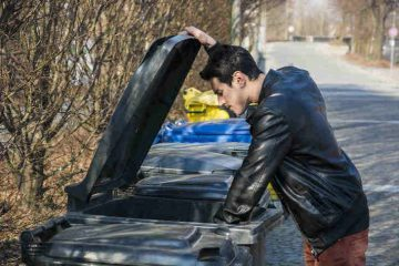 man going through garbage - dumpster diving