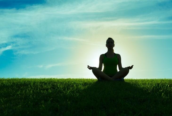Meditator - meditating on grass