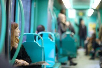 Lone woman on tram - Poems by Wendy E. Slater