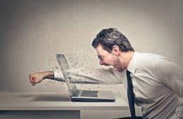 Angry man - punching computer