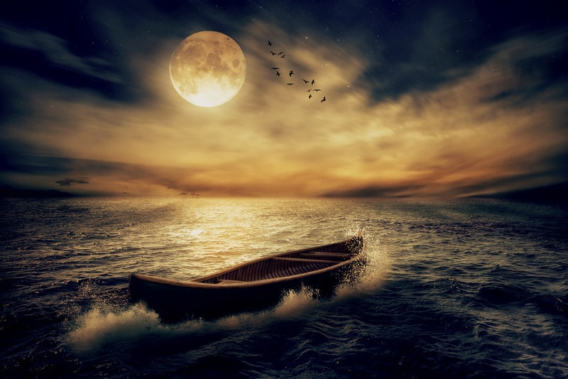 Full moon on the sea with boat running free