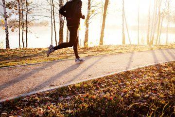 Man running on trail in autumn - Running towards clarity