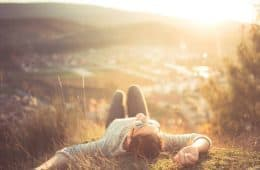 "Woman lying down at mountaintop - Life in ""high definition"""