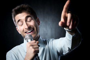 Man behind a microphone speaking