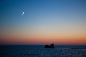 New crescent moon over sea - Poems by Julie Lauton