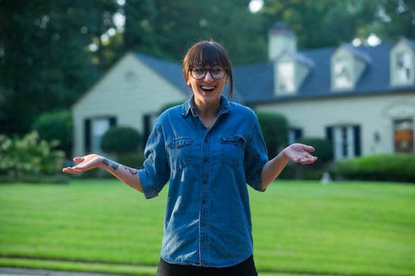 Young woman in front of home - Fear as desire unexpressed