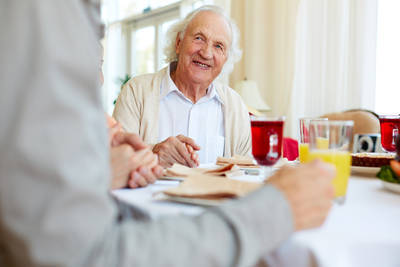 Elderly father and son eating together - The secret language of fear