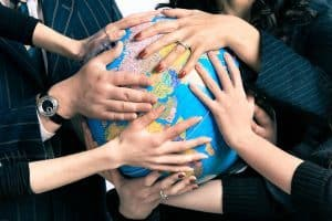 Various hands holding globe - The Vitality Map excerpt