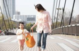 Mother and daughter with reusable shopping bag - Designing a sustainable lifestyle