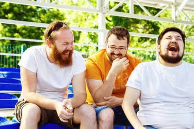 Three guys laughing - Laugh your way to higher consciousness