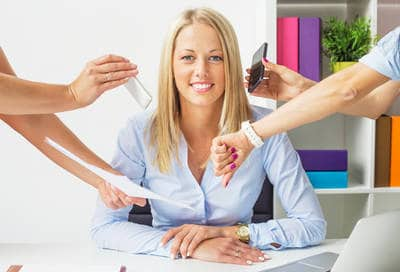 Businesswoman ignoring distractions - Mindfully accepting non-acceptance