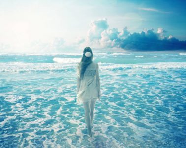 Woman walking on cloudy beach - Even When Trapped Behind Clouds book review