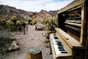 old piano in a backyard in the desert