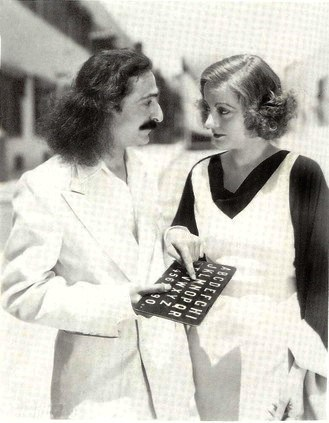Meher Baba with Tallulah Bankhead and his alphabet board - Downton Abbey and spiritual values