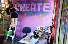 "Woman painting the word create on a wall - ""I want to be creative"""