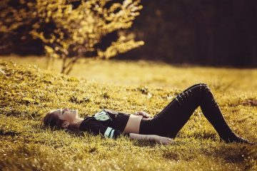 Young girl lying on the grass